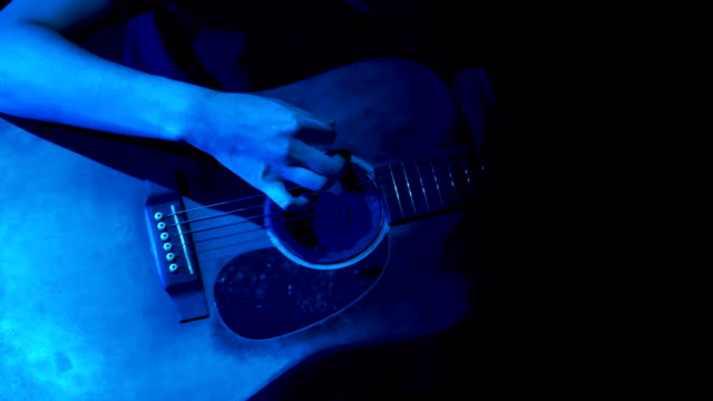 close up of guitar player on stage at night - guitar stock videos & royalty-free footage