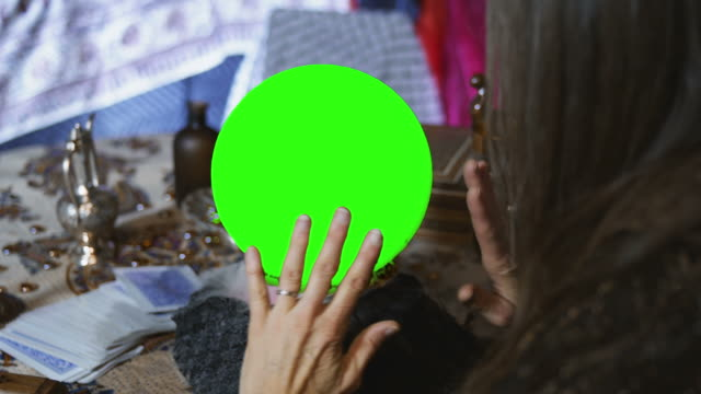 Close Up of Gypsy Looking at a Crystal Ball