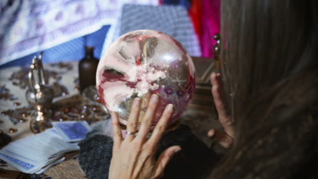 Close Up of Gypsy Looking at a Crystal Ball