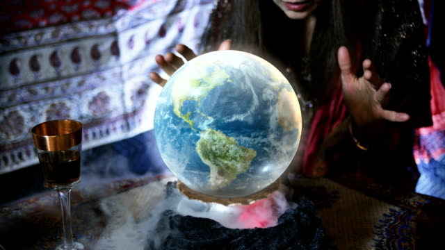 close up of gypsy looking at a crystal ball - crystal ball stock videos & royalty-free footage