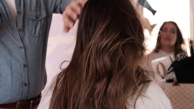 close up of hairdresser drying woman's hair in the salon. - hair treatment stock videos and b-roll footage