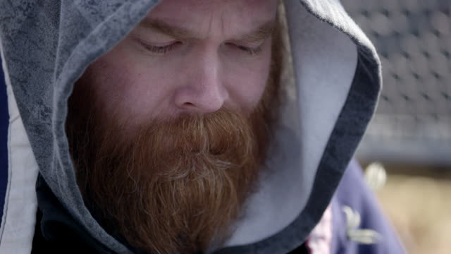 close up of hairy mans face wearing hoodie - homelessness stock videos & royalty-free footage