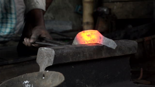 close up of hammering red hot sickle by an indian blacksmith. - west bengal stock videos and b-roll footage