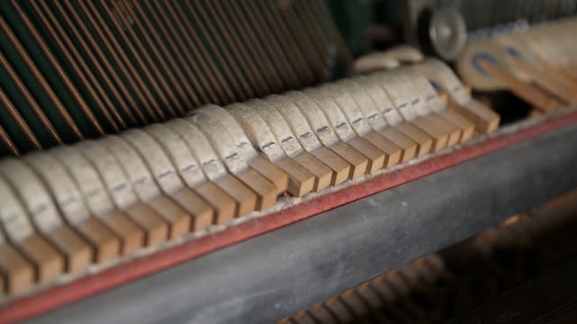 close up of hammers vibrating strings inside a piano - music stock videos & royalty-free footage