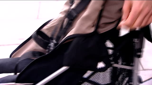 close up of hand folding maclaren buggy over protective sleeve on hinge - sleeve stock videos & royalty-free footage