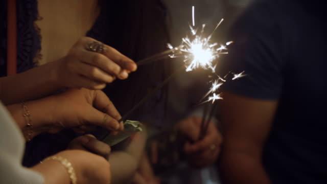 Close up of hand holding sparkler