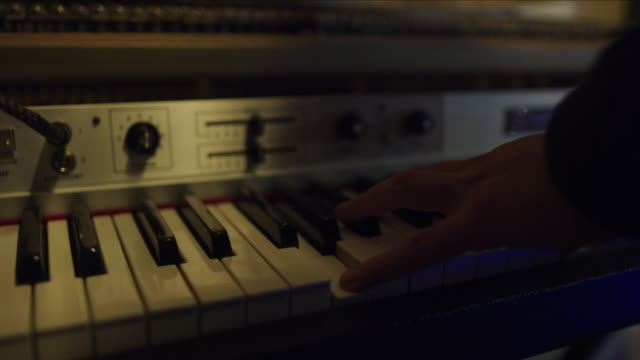 stockvideo's en b-roll-footage met close up of hand of man playing synthesizer keyboard / provo, utah, united states - provo