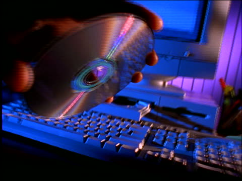 close up of hand putting cd into cd-rom drive on computer - cd rom stock videos & royalty-free footage