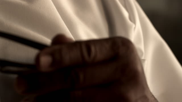 close up of hand taking glasses out of pocket then putting them back. - inserting stock videos & royalty-free footage