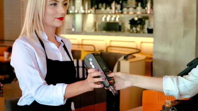 close up of hand using credit card swiping machine to pay. woman entering credit card code in swipe machine. - order stock videos & royalty-free footage