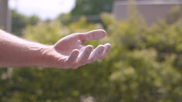 close up of hands clapping with talcum powder - kletterwand kletterausrüstung stock-videos und b-roll-filmmaterial