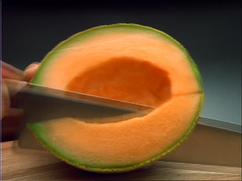 close up of hands cutting cantaloupe with knife - slice stock videos & royalty-free footage
