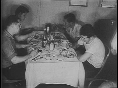 close up of hands flipping through war ration book two / ration books being printed at large press / view of books running through printer / people... - dining room stock videos & royalty-free footage
