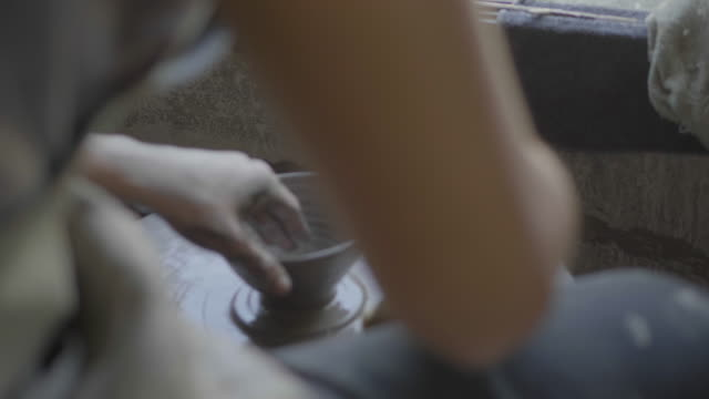 close up of hands of a potter, creating a cup on the circle wheel - stock video - potter stock videos & royalty-free footage