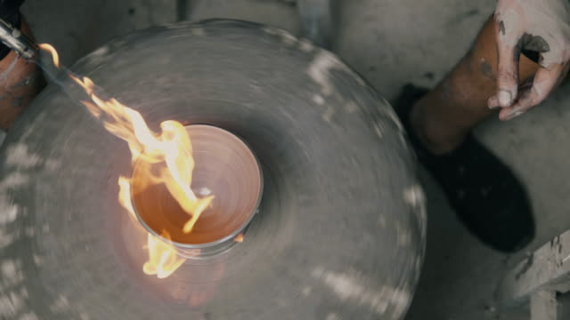 close up of hands of a potter, creating a cup on the circle wheel while using fire spray foam- stock video - pottery stock videos & royalty-free footage