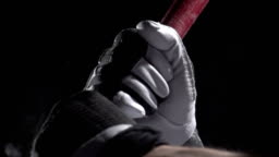 Close up of hands on a baseball bat, slow motion