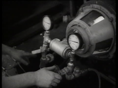 b/w close up of hands on valves of engine of steam train / new jersey / sound - locomotive stock videos and b-roll footage