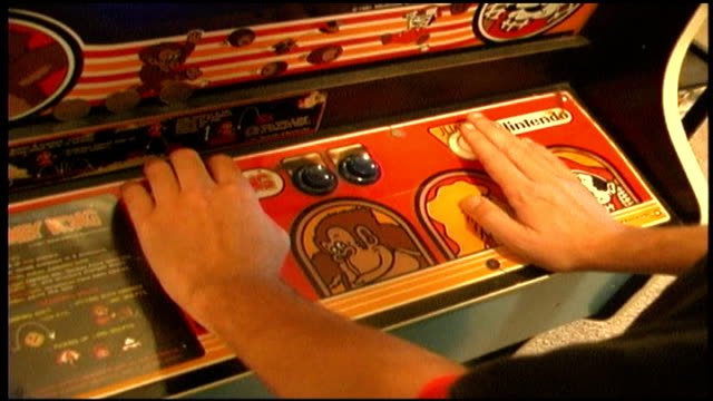 Close Up of Hands Playing Donkey Kong Arcade Game