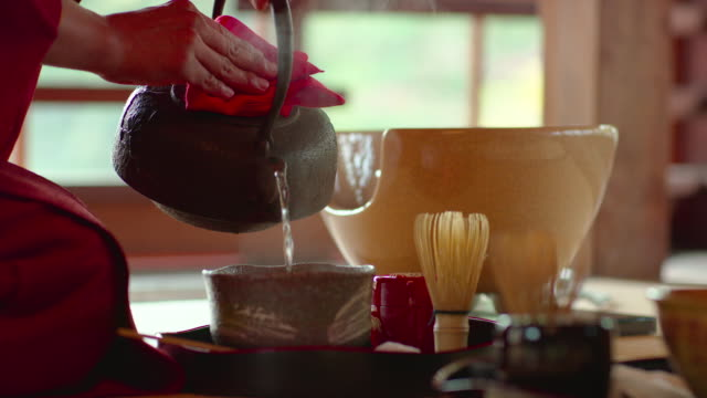 close up of hands pouring tea as part of a japanese tea ceremony. - traditional ceremony stock videos & royalty-free footage