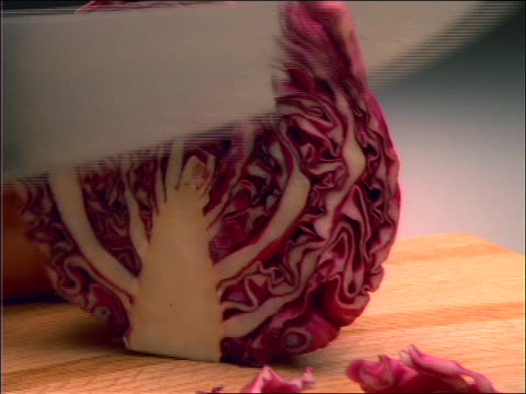 close up of hands slicing cabbage with knife - crucifers stock videos & royalty-free footage