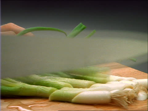 close up of hands slicing scallions with knife - onion stock videos & royalty-free footage