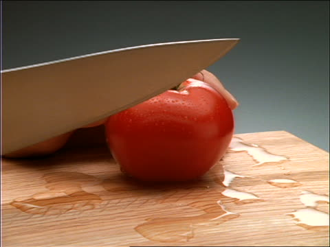 close up of hands slicing tomato with knife - tomato stock videos & royalty-free footage