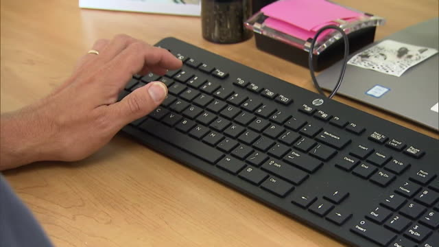 close up of hands typing on a keyboard - new england usa stock videos & royalty-free footage