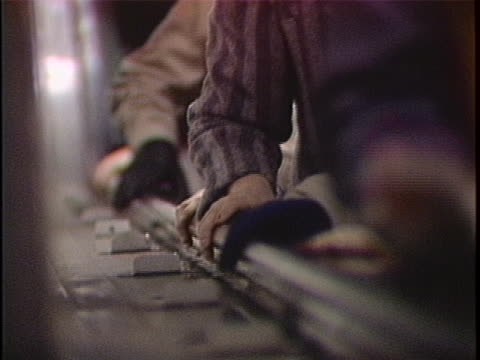 vidéos et rushes de close up of hands using the handrail of the escalators in the nyc subways. - railings