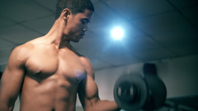 close up of handsome man exercise with weights - arm curl stock videos and b-roll footage
