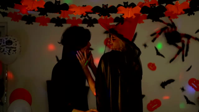 close up of happiness man and woman wearing halloween costumes dancing in the party. smiling people in halloween costumes celebrating halloween party - count dracula stock videos & royalty-free footage