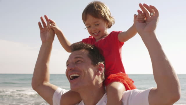 close up of happy little girl on her father's shoulders/marbella region, spain - tre quarti video stock e b–roll