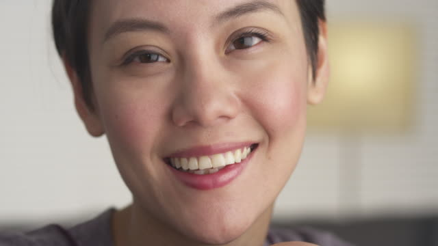 close up of happy woman's face - chinesischer abstammung stock-videos und b-roll-filmmaterial