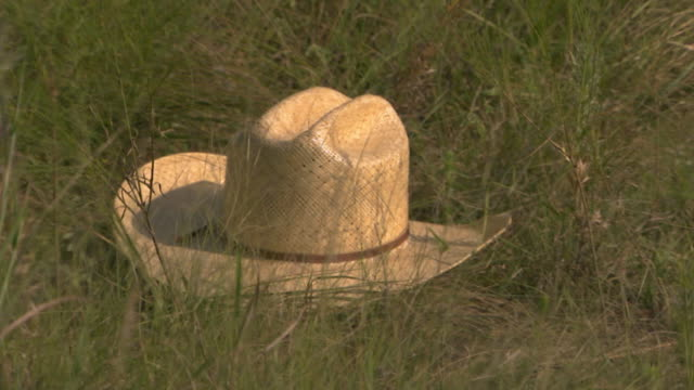 close up of hat laying out in a field - cowboy hat stock videos & royalty-free footage