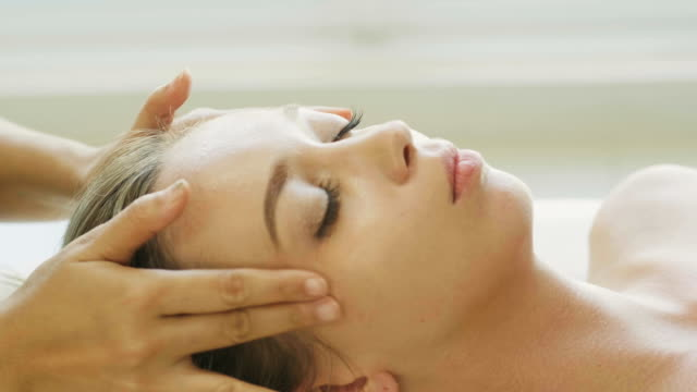 close up of head massage of beautiful woman with feeling relaxation - head massage stock videos and b-roll footage