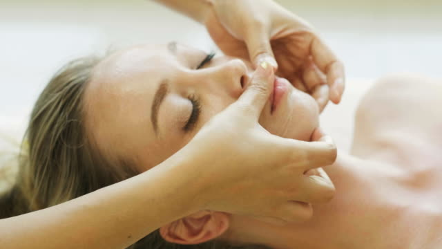 close up of head massage of beautiful woman with feeling relaxation - facial massage stock videos and b-roll footage