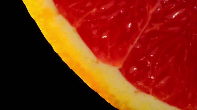 close up of healthy blood orange slowly rotating black background - ascorbic acid stock videos & royalty-free footage