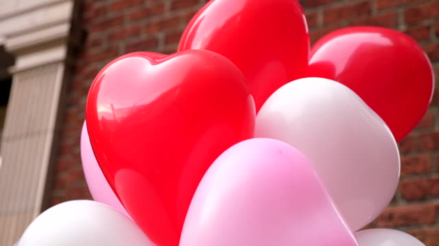 cu close up of heart shaped balloons on valentines day - valentine's day stock videos & royalty-free footage