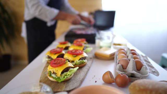 close up of homemade cheeseburgers - cheeseburger stock videos & royalty-free footage