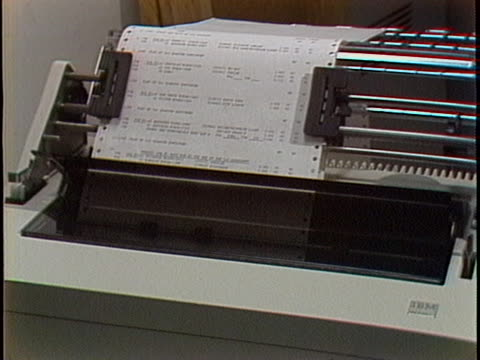 close up of ibm logo zooms out to show computer monitor, and hands typing on a keyboard. on the monitor we see an old word processor being used.... - desktop pc stock videos & royalty-free footage