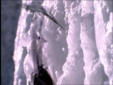 close up of ice climber's ice pick hitting icy cliff face - climbing equipment stock videos and b-roll footage