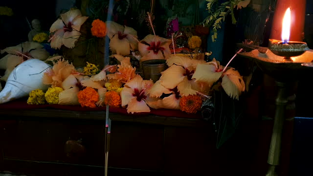 close up of incense smoke stream flowing up in front of wooden temple with holy flowers and religious deities at the background - conch stock videos & royalty-free footage
