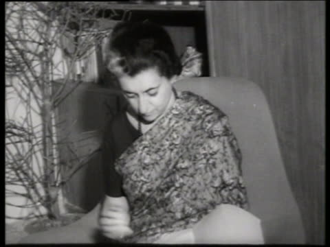 b/w close up of indira gandhi writing at home / 1960's / sound - indira gandhi stock videos & royalty-free footage
