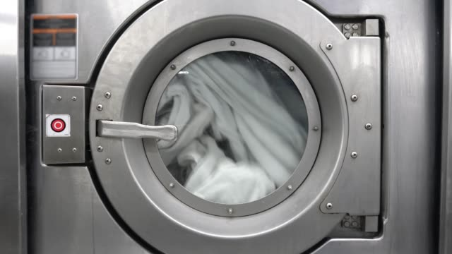 close up of industrial dryer at a laundromat - washing stock videos & royalty-free footage