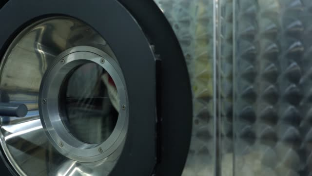 close up of industrial dryer machine at a laundry service - laundry stock videos & royalty-free footage