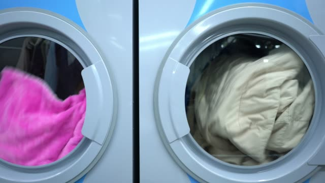 close up of industrial washing machines and dryer machines at a laundry service - launderette stock videos & royalty-free footage
