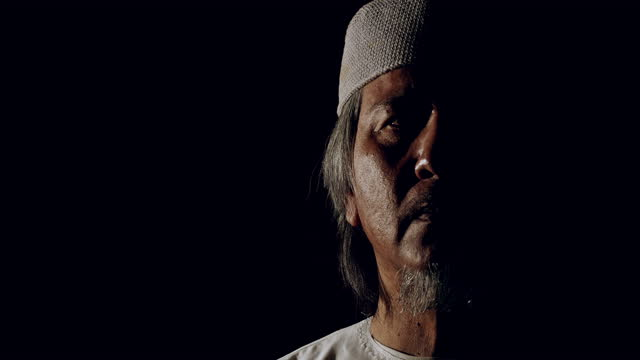 close up of islam man portrait. south east asian culture, slow motion, back lit. - one mid adult man only stock videos & royalty-free footage