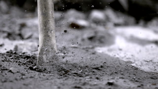 stockvideo's en b-roll-footage met close up of jackhammer chisel (super slow motion) - steen rots