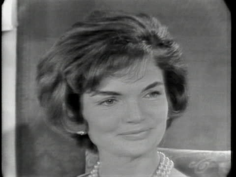 """close up of jacqueline kennedy. she has short hair and is wearing a pearl necklace. she says: """"one can make one's private bedrooms as one wishes.... - jackie kennedy stock videos & royalty-free footage"""