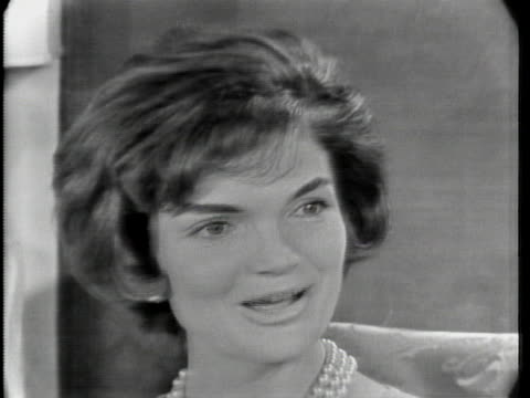 """close up of jacqueline kennedy. she has short hair and is wearing a pearl necklace. she says: """"if she's in the papers all the time, that will affect... - jackie kennedy stock videos & royalty-free footage"""