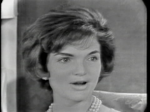 """close up of jacqueline kennedy. she has short hair and is wearing a pearl necklace. she says: """"there's so little privacy. i don't mind for myself,... - jackie kennedy stock videos & royalty-free footage"""